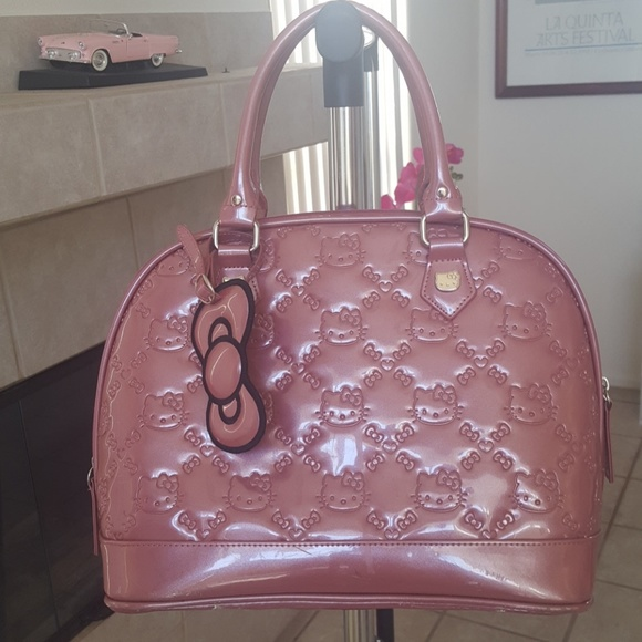 7c3b07c404 loungefly Handbags - Hello Kitty Loungefly purse bag pink